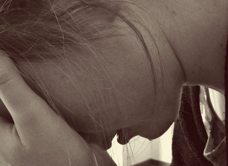 Woman Crying at Domestic Violence Counselling Session