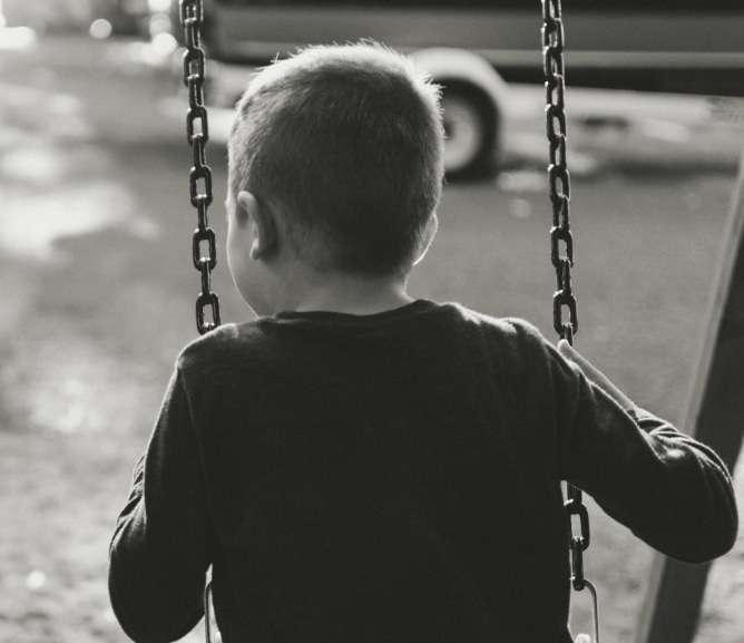 Boy Swinging on Swng