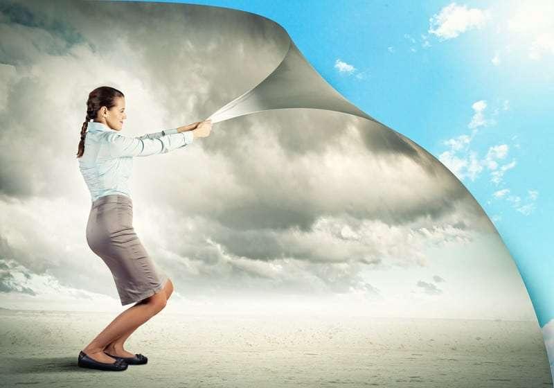 Woman Pulling Dark Clouds Away to Get Blue Skies